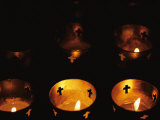 Votives Burn in a Darkened Church in Santa Fe