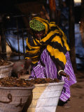 Local Woman Setting Up to Sell Dried Fish in Mopti Harbour, Mopti, Mali