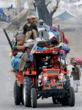 A Pakistan Earthquake Survivor Family Ride a Vehicle as They Make Their Way to Mansehra