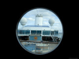 Looking Down on the Pool Deck of a Cruise Ship Through a Porthole