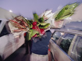 As Day Dawns, a Buyer Shoulders Exotic Fare at the San Francisco Flower Mart