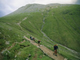 A Team of Hikers Climb Scotlands Ben Nevis Peak