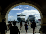 People Walking Through Port Entrance to Two Cruise Ships