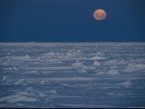 Full Moon Rising over Pack Ice