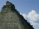 Tourists Scale the Steep Steps of the Pyramid of the Magician