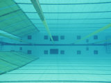 An Underwater Picture of an Indoor Swimming Pool