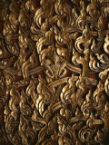 Ornate Flame-Like Carving Surrounds Buddha on a Relief Sculpture