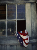 An American Flag Lies Loosely Bunched in an Open Window