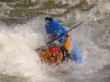 A Whitewater Kayaker Getting Vertical Doing Rodeo Moves