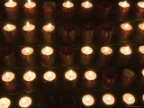 A Close View of Votive Lamps in a Church