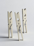 Three Old-Fashioned Wooden Clothes Pegs