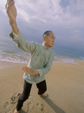 Buy Senior Man Practicing Tai Chi on the Beach at AllPosters.com