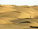 A Visitor Stands on Sand Dune in the Taklimakan Desert Photographic Print