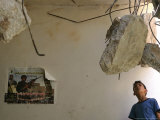 A Palestinian Boy Looks Inside the Damaged House of Militants Moatasm Sharaidi and Elias Ashkar
