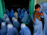 Afghan Women Wearing Burqas Listen to a Speech by Presidential Candidate Massooda Jalal