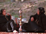 Two Unidentified Iranian Women Smoke a Water Pipe