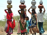 Women Carry Water at Lat Village