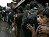 Pakistanis Wait in Line to Receive Food as Aid