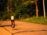 Boy Riding Bike on Dirt Road, Ko Samui, Surat Thani, Thailand
