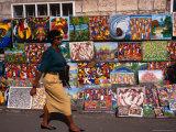 Woman Walking Past Art Stall, St. John
