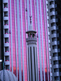 Minaret of Mosque Against Pink Sunset Reflected in Building, Dubai, United Arab Emirates