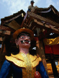 Buddhist Monastery Statue and Worker at Xishuangbanna, Yunnan, China
