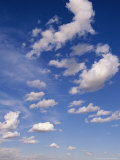 Cumulus Clouds Above the Masai Mara National Reserve Photographic Print