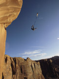 Base Jumper Leaping with a Parachute From the Tombstone Formation