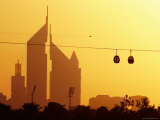Creekside Park Cable Cars Passing the Emirates Towers at Sunset