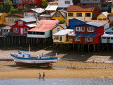 Brightly Painted Stilt Houses on Waterfront
