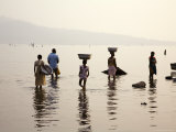Ghanaians Collecting Water from Lake Volta at Dusk