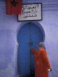 Woman Exits thru Moorish-Style Blue Door, Morocco