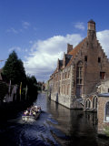 Hans Memling Museum and Canal Boat on the River Dijver, Bruges, Belgium
