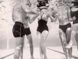 Underwater Shot of Actress Daphne Dayle in Topless, One Piece Swim Suit by Designer Ruben Torres