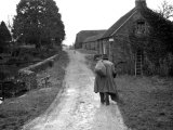 Tramp Named John Walpole Walking in Village Carrying Bag over His Shoulder