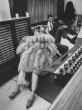 Singer Barbra Streisand in Silver Fox Fur Coat, Listening Intently to Playback of Her Recordings
