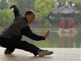 Man Doing Tai Chi Exercises at Black Dragon Pool with One-Cent Pavilion, Lijiang, China