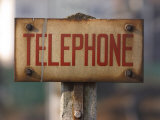 Close-Up of Singed Telephone Sign Outdoors