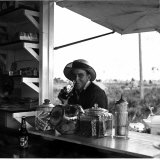 Young Man at Outdoor Food Stand Drinking a Coke