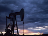 Oil Rig Silhouetted at Sunset, Adobe Town, Wyoming