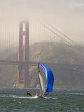 International 14 Skiff Sails under the Golden Gate Bridge, San Francisco Bay, California