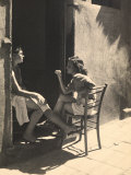 Two Girls Sitting on a Doorstep