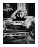 Marilyn Monroe Reading Motion Picture Daily, New York, c.1955 - Poster Print