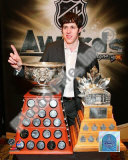 Evgeni Malkin with the Art Ross Trophy and Conn Smythe Trophy