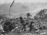 American Marine Hurls Hand Grenade Towards Japanese Position as His Partner Prepares to Do the Same