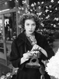 Fashion Model Suzy Parker with a Camera