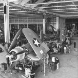 Men Working on the Aircrafts Final Constructing Stages