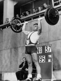 Iranian Weight Lifter M. Namdjou Struggling to Hold Up 206.5 Pound Weight at 1952 Olympics