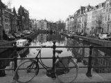 Black and White Imge of an Old Bicycle by the Singel Canal, Amsterdam, Netherlands, Europe