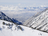 Salt Lake Valley and Fresh Powder Tracks at Alta, Alta Ski Resort, Salt Lake City, Utah, USA